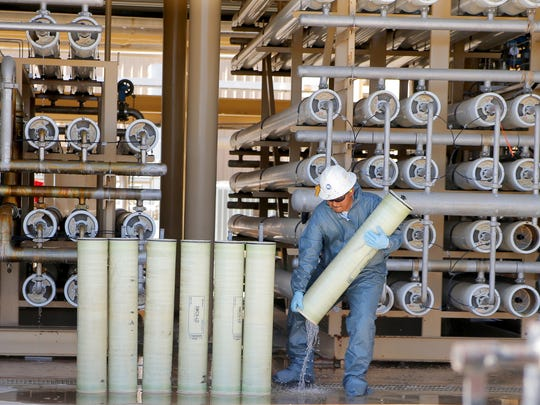 A worker changes a filter at Chevron's reverse osmosis facility at the San Ardo oil field in south Monterey County.