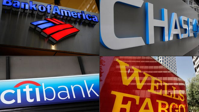 This file photo combination shows bank branches of, clockwise from top left, Bank of America, Chase, Wells Fargo, and Citibank.