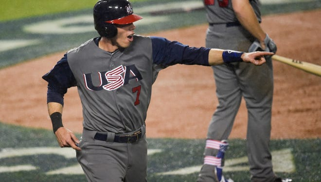 United States left fielder Christian Yelich (7) celebrates after scoring a run against Japan during the fourth inning of the 2017 World Baseball Classic at Dodger Stadium.