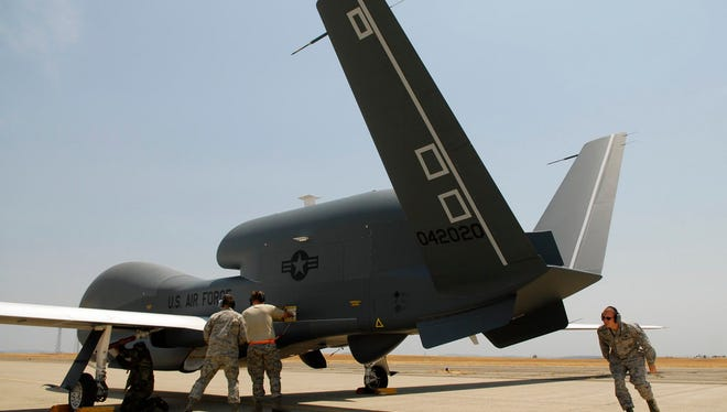 FILE - In a Monday, June 30, 2008, file photo, Beale Air Force Base Airmen work on an RQ-4 Global Hawk into its hangar at Beale Air Force Base in Yuba County, Calif. An RQ-4 Global Hawk crashed in a remote section of eastern California near Mt. Whitney.