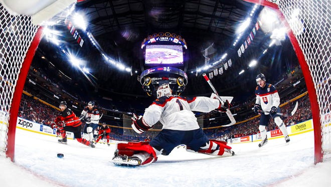 Canada's Jonah Gadjovich, left, scores against Slovakia goalie David Hrenak during the second period of IIHF World Junior Championship preliminary round hockey game action in Buffalo, N.Y., Wednesday, Dec. 27.