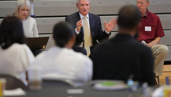 Marquette University President Mike Lovell leads a breakout group during a meeting for a new collaboration meant to tackle the crippling epidemic of neurological trauma in Milwaukee. Called SWIM, for Scaling Wellness in Milwaukee, Lovell wants to coax strategic coordination among Milwaukee's disjointed trauma-responsive initiatives.