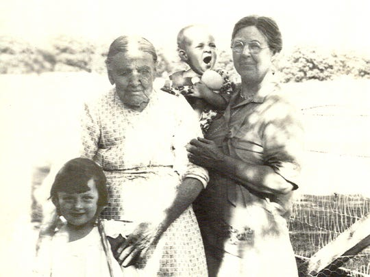 Pat Heiskell Hillman, 1, is pictured in her grandmother Eva App Heiskell's arms in 1930. Pat Hillman's older sister, Eleanor Heiskell, 4, at left, is next to the girls' great-grandmother Leanna Charity Donner App, 92. The great-grandmother was one of the five Donner sisters who who crossed the Sierra Nevada as children in the Donner Party. All five girls survived but their parents perished.