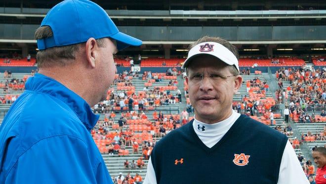 Auburn coach Gus Malzahn talks with Louisiana Tech coach Skip Holtz before Saturday's game.