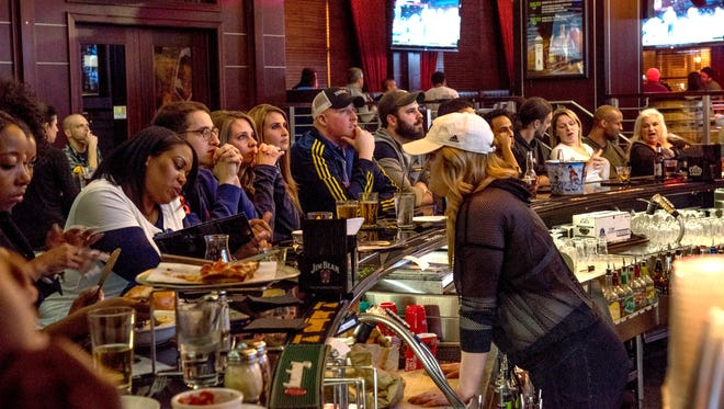 U of M fans watch the start of the NCCA title game between the Michigan Wolverines and the Villanova Wildcas at Hamlin Corner in Royal Oak on April 2, 2018.