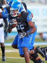 MTSU running back Terelle West carries the ball in