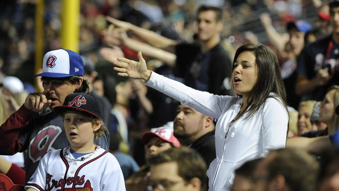 Atlanta Braves fans do the tomahawk chop during the ninth inning of a game against the San Francisco Giants on May 2, 2014, in Atlanta. San Francisco won 2-1.