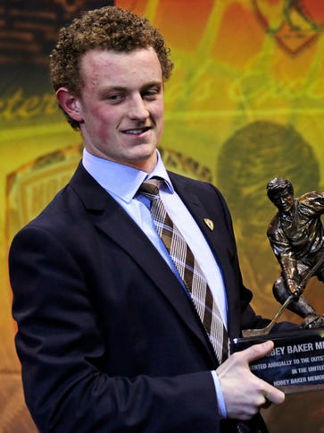 Boston University forward Jack Eichel hold the Hobey