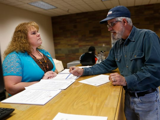 San Juan County Deputy Clerk Tanya Shelby helps state Senate District 1 candidate Matt Dobson file for candidacy, Tuesda at the San Juan County Clerk's Office in Aztec.