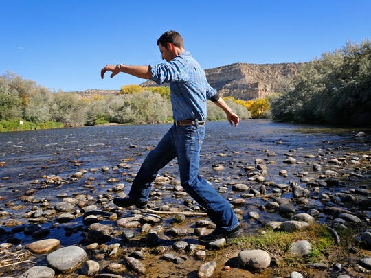 """Jake Chavez, owner of Majestic Enchantment Fly Fishing, walks along a portion of his property on Tuesday. Director Terrence Malick shot footage for his documentary """"Voyage of Time"""" at the Blanco business in 2012"""