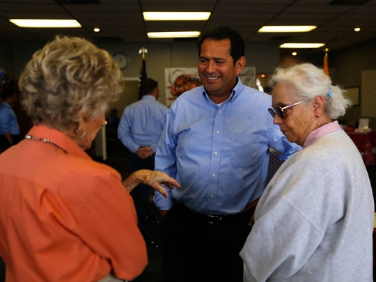 New Mexico Lt. Gov. John Sanchez talks with Betty Berry, left, and LaVon Lamphere, on Monday during a visit to the San Juan County Republican Party Headquarters in Farmington.