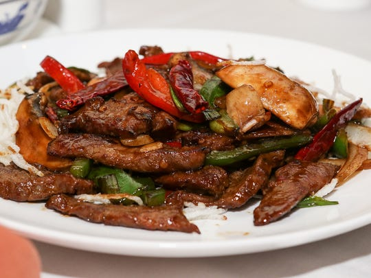 Table feature at House of Wong at 475 Union Ave, Bridgewater on August 28, 2015.Spicy Mongolian Beef - Served with fresh mushroom, bell pepper, onion, scallion and chili pepper sauce.