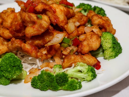 Table feature at House of Wong at 475 Union Ave, Bridgewater on August 28, 2015.Singaporean Chili Chicken - Crispy fired chicken breast with red bell pepper, hot pepper, and onion.