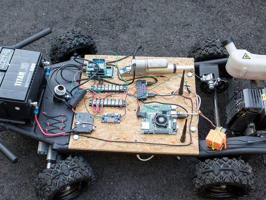 DriveAI team members demonstrate an autonomous (self-driving)