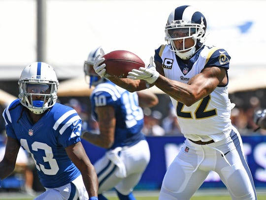Rams cornerback Trumaine Johnson intercepts a pass in front of Colts receiver T.Y. Hilton in the first quarter Sept. 10, 2017 at the Coliseum in Los Angeles.