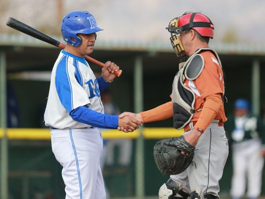 Opponents shake hands as a game gets underway.