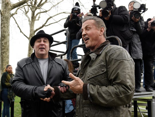 Sylvester Stallone, right, greets Rocky impersonator