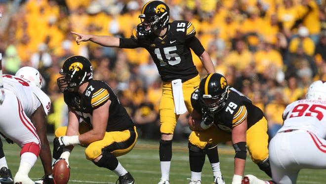 Iowa quarterback Jake Rudock calls a play against Indiana on Saturday, Oct. 11, 2014, at Kinnick Stadium in Iowa City, Iowa.