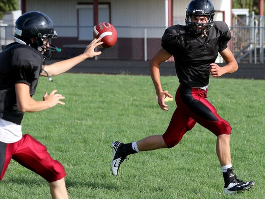 Perrydale running back Brant Barnes brings in a toss during practice earlier this week.