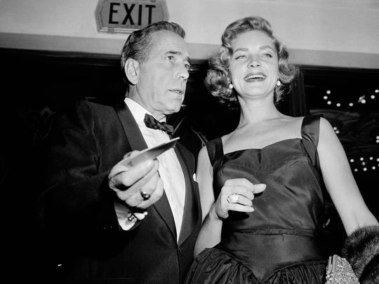 """FILE - This Oct. 12, 1955 file photo shows actors Humphrey Bogart, left, and his wife, Lauren Bacall at the premiere of """"The Desperate Hours,"""" in Los Angeles. Bacall,  died Tuesday, Aug. 12, 2014 in New York. She was 89. (AP Photo/Harold Filan, FIle)"""