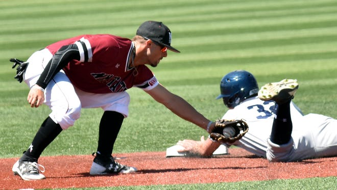 Aggie shortstop L.J. Hatch tries to put the tag on a University of Northern Colorado base runner Saturday afternoon at Presley Askew Field.