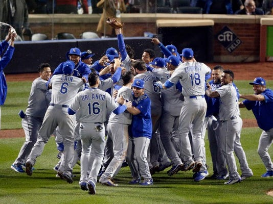 Member of the Kansas City Royals celebrates after Game 5 of the Major League Baseball World Series against the New York Mets Monday, Nov. 2, 2015, in New York. The Royals won 7-2 to win the series. (AP Photo/Charlie Riedel)