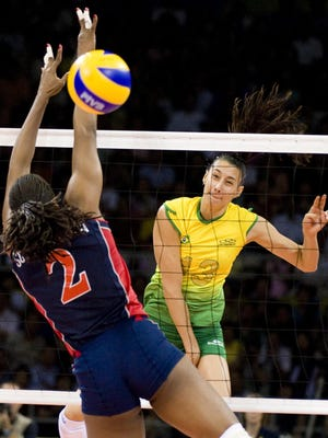 Sheilla Castro of  Brazil spikes past Danielle Scott-Arruda of the United States on Aug. 23, 2008, in the gold medal match of the Beijing Olympics. Castros has come of retirement to play in the U.S.