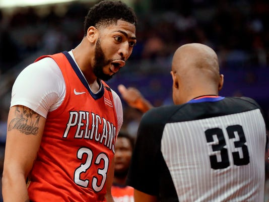 FILE - In this April 6, 2018, file photo, New Orleans Pelicans forward Anthony Davis (23) argues a foul call against him by referee Sean Corbin (33) during the second half of an NBA basketball game against the Phoenix Suns, in Phoenix. This was a season that saw superstars get ejected, a referee held out of games for a week after getting too aggressive with a player and the NBA going door-to-door to remind teams to play nice. The referee-player relationship is as thorny as ever, and that's not a good thing going into the postseason. (AP Photo/Matt York, File)