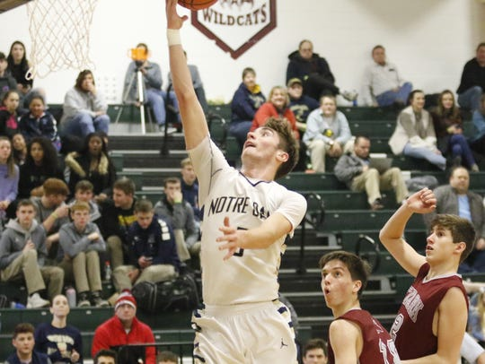 Elmira Notre Dame's Gary Raupers scores two of his 23 points Thursday during day two of the Josh Palmer Fund Elmira Holiday Inn Classic at Elmira High School.