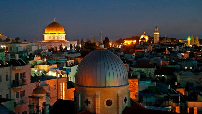 A picture taken on Dec. 4, 2017 shows a general view of the skyline of the old city of Jerusalem, with the Dome of the Rock, left, in the Aqsa Compund.