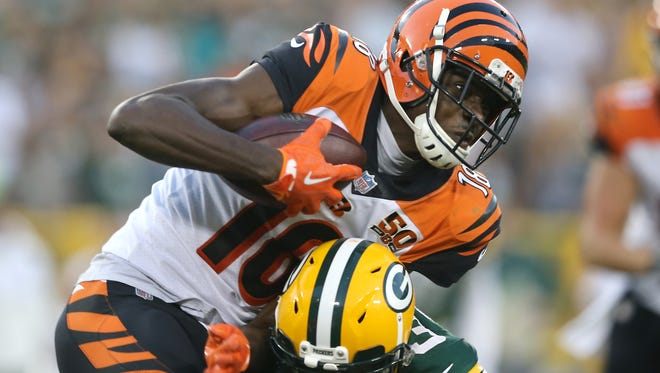 Cincinnati Bengals wide receiver A.J. Green (18) makes a catch in overtime during the Week 3 NFL football game between the Cincinnati Bengals and the Green Bay Packers, Sunday, Sept. 24, 2017, at Lambeau Field in Green Bay, Wisconsin.