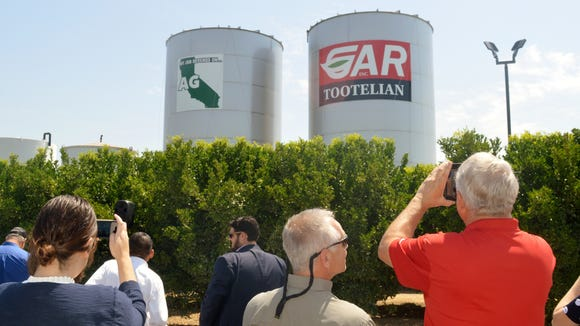 People stood and watched as GAR Tootelian Inc., unveiled the largest My Job Depends on Ag decal  on one of their 75,000 gallon steel container. The unveiling took place  Tuesday morning at the second anniversary of the My Job Depends on Ag launch.