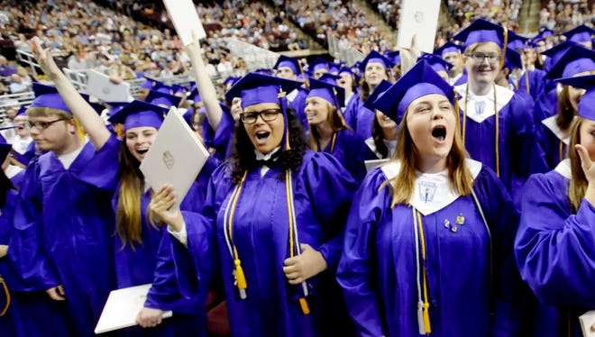 Benton seniors cheer when it is announced they are graduates Saturday afternoon at the CenturyLink in Bossier City.