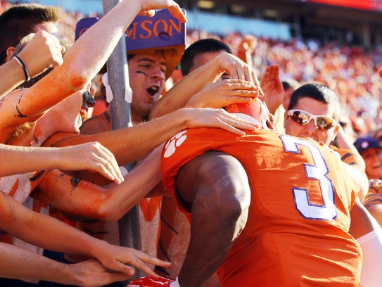 Clemson defensive end Vic Beasley (3) celebrates with