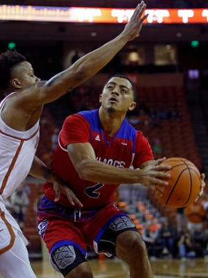 Louisiana Tech guard Jalen Harris, right, looks to shoot against Texas guard Jacob Young, left, during their game earlier this season.