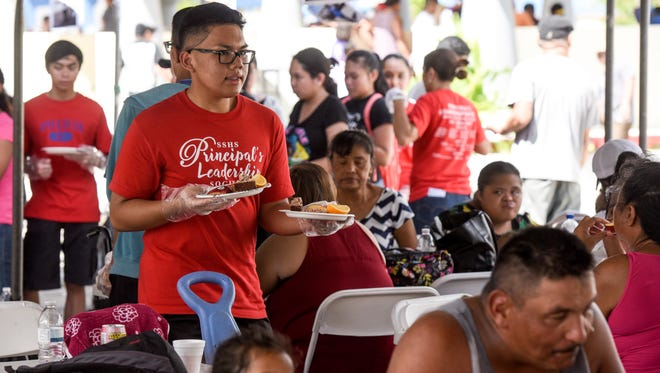 Some of the island's residents attend The Salvation Army's annual Thanksgiving Day feast behind the Chamorro Village in Hagåtña on Thursday, Nov. 23, 2017.
