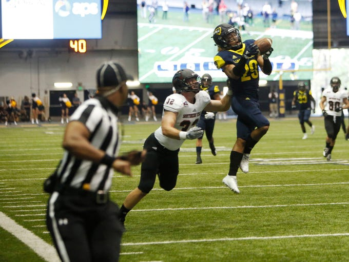 Northern Arizona University's Khalil Dorsey (29) intercepts