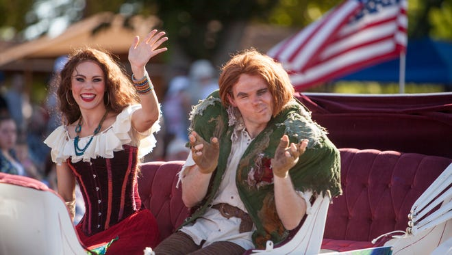 Performers from the Tuacahn production of Hunchback of Notre Dame ride in the Pioneer Day parade in Washington Saturday, July 23, 2016.