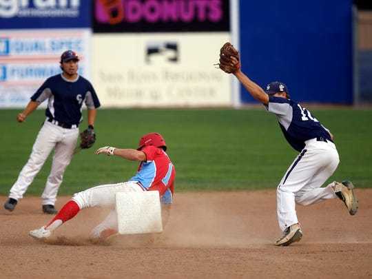 Connecticut Bombers's Zach Ardito tags D-BAT Elite 17U's Noah Sifrit as he attempts to steal second base on Tuesday in Game 15 of the Connie Mack World Series at Ricketts Park in Farmington.