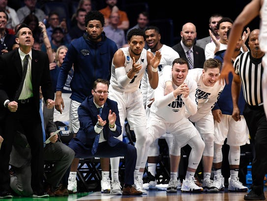 Nevada players celebrate during the second half of