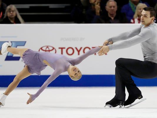 Alexa Scimeca-Knierim, left, and Christopher Knierim perform during the pairs free skate event at the U.S. Figure Skating Championships in San Jose, Calif., Saturday, Jan. 6, 2018. (AP Photo/Tony Avelar)