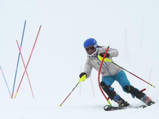Ski development program racer Lauren Palermo runs gates during a training session at Squaw Valley Ski Area near Truckee, Calif. on Jan. 16, 2015.
