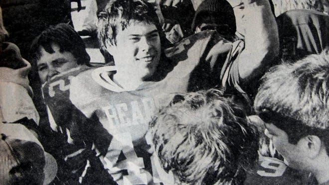 Yorkwood's Mike Ricketts is pictured celebrating the Golden Bears' 1983 state title. During a six-year, 72-game span of football in the 1980s, Ricketts was on the losing side only twice.