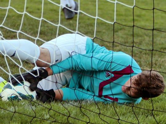 Eagles Cameron Gwinn makes a diving save.jpg