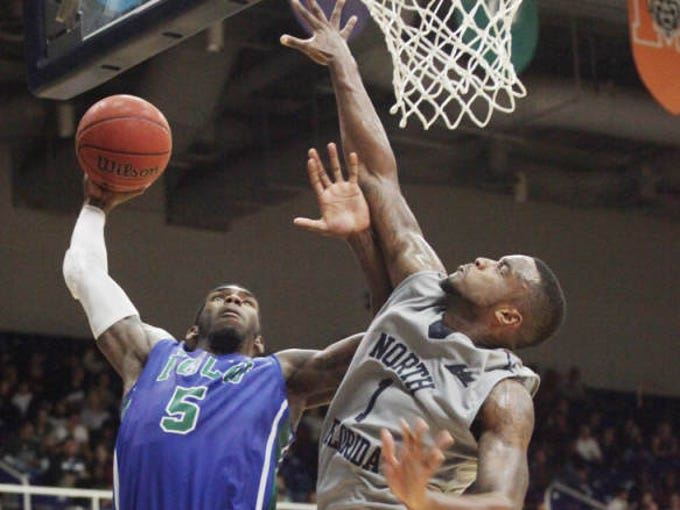 FGCU's Jamail Jones shoots over University of North Florida's Travis Wallace during a game on Thursday in Jacksonville.