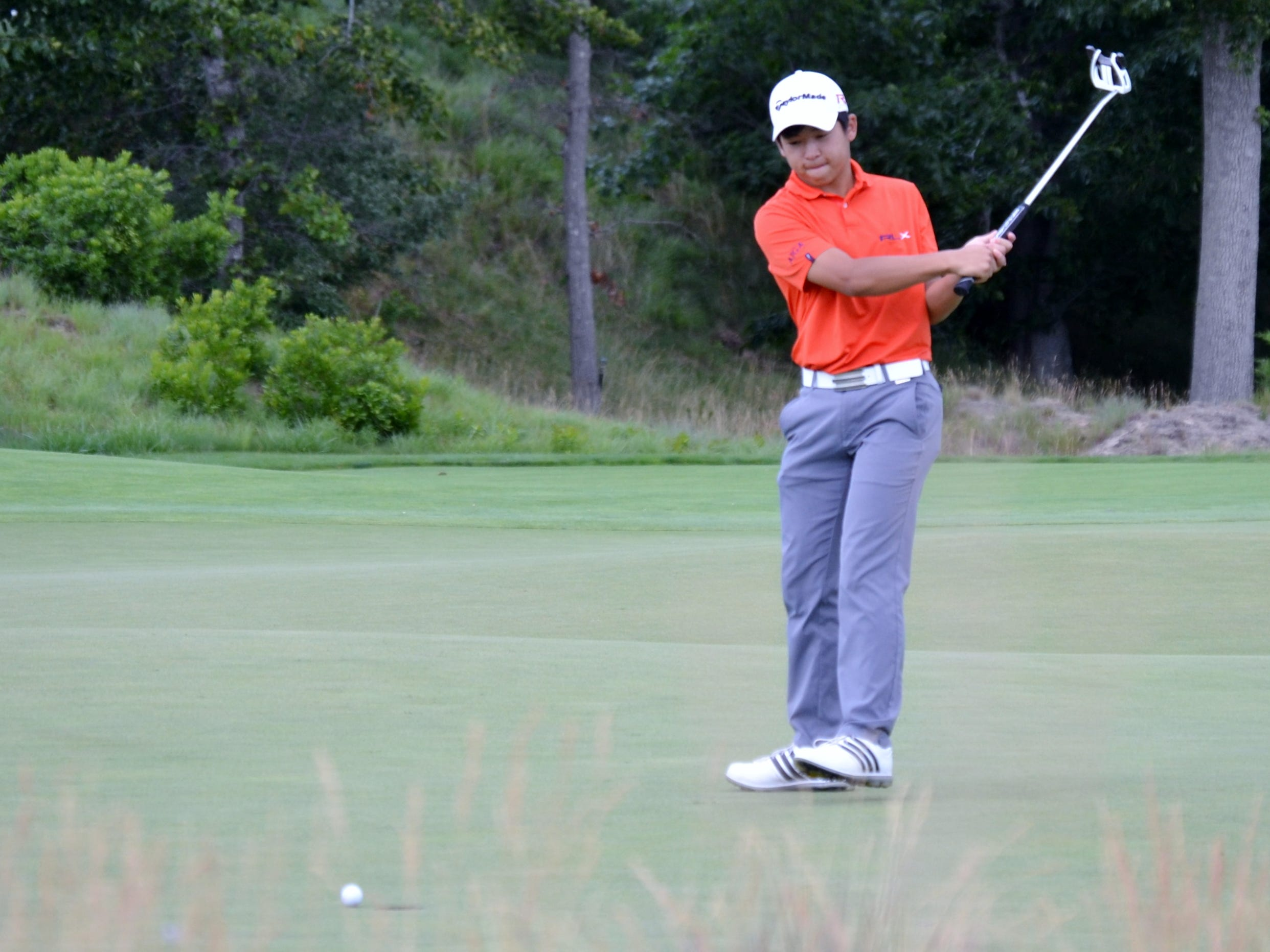 Brent Ito reacts to a missed birdie putt on the ninth hole at Friar's Head Golf Club Monday during the first round of The Ike Championship. The senior at Ardsley High School opened with a 1-under 70 and is tied for fifth. (Photo: Mike Dougherty/The Journal News)