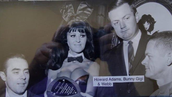 "Businessman Howard Adams (left), ""Bunny Gigi"" and Playboy Club general manager Webb Ellis in 1968 visit with Thomas Goggin, president of the Arizona Paralyzed Veterans of America."