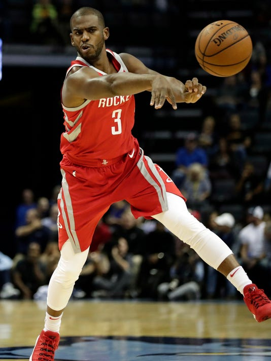 """FILE - In this Oct. 11, 2017, file photo, Houston Rockets guard Chris Paul (3) passes against the Memphis Grizzlies in the first half of an NBA preseason basketball game in Memphis, Tenn. Paul had a new home in Los Angeles and the potential for a $200 million contract if he stayed with the Clippers. He also had reason to doubt a championship would ever come there. So he threw himself into the free agency process and ended up in Houston, the subject of a three-part documentary series titled """"Chris Paul's Chapter 3"""" that debuts Thursday, Oct. 19, on ESPN. (AP Photo/Rogelio V. Solis, File)"""