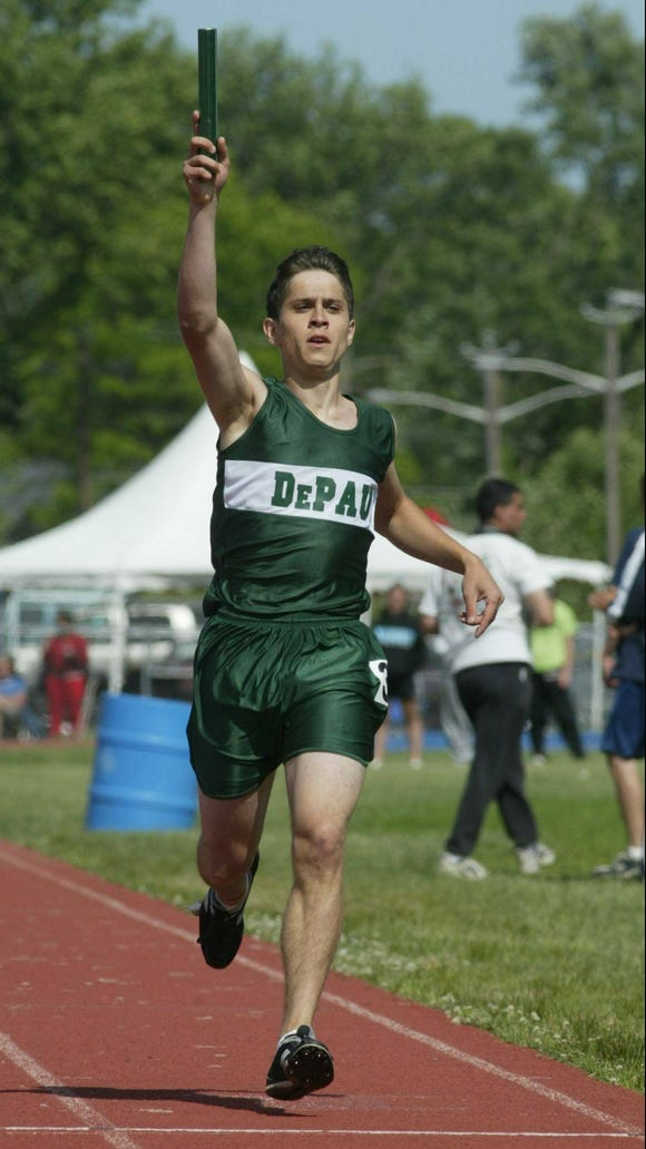 From 2004: Val Sisti of DePaul crosses the finish line as he wins the anchor leg of the 4x400 relay.