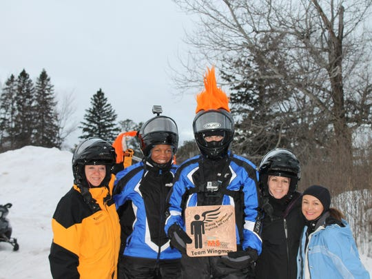 """Texas residents Christy """"Ethel"""" Chaney, Michelle Stroud, Chris Potter, Patricia Revollo and Melissa Potter came to Wisconsin specifically for the 2015 MS Snowmobile Tour. """"The MS Snowmobile Tour was an amazing experience that challenged me to step out of my 'Texas Weather Comfort Zone' and I learned that I was capable of more than I thought I could ever achieve,"""" Chaney said."""